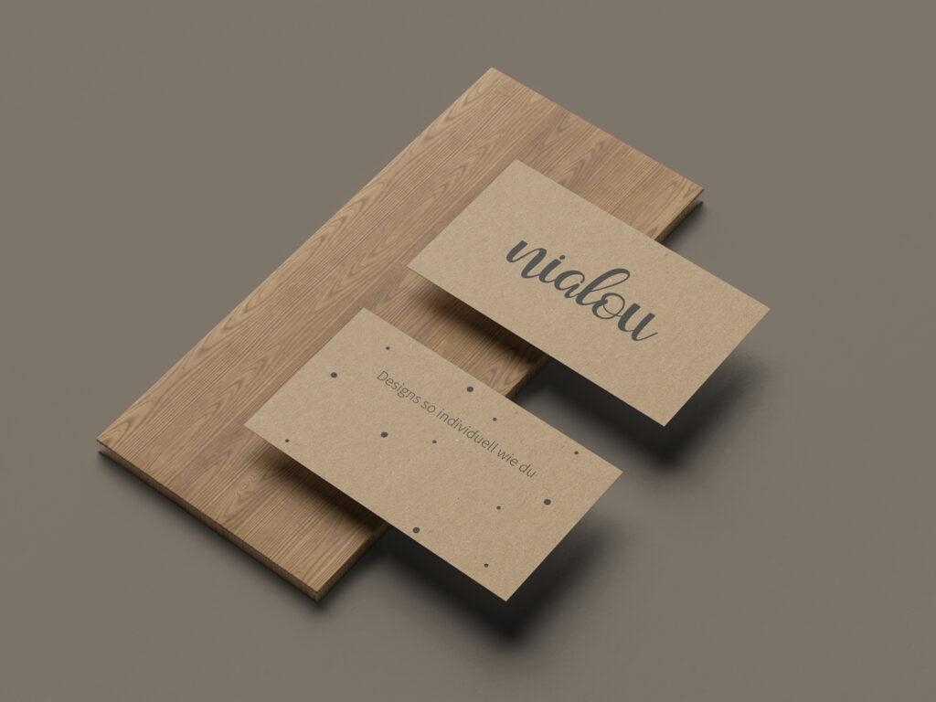 Nialou, Visitenkarten, Packpapier